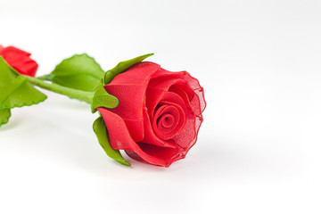artificial red rose on white background