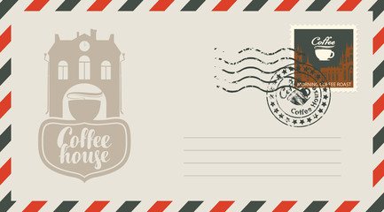 an envelope with a postage stamp for a coffee house with a vintage building and cups