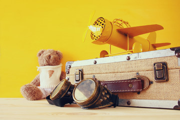 Photo of vintage toy plane and cute teddy bear