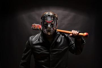 Psycho killer in hockey mask on black background. - fototapety na wymiar