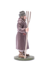 tin soldier man with a pitchfork Isolated on white
