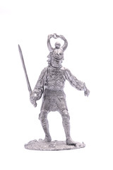 tin soldier medieval knight with sword isolated on white