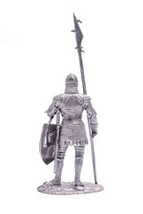 tin soldier medieval knight with spear and shield isolated on wh
