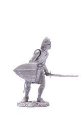 tin soldier medieval knight with sword and shield isolated on wh