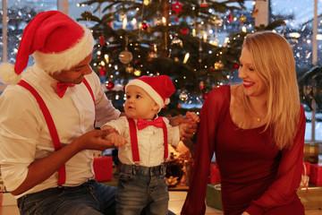 Interracial family celebrating christmas