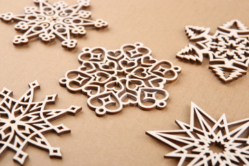 Laser cut wood snowflakes ornaments.  Wooden snowflakes on carton.