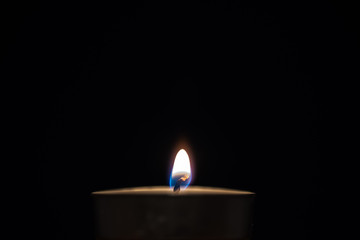Candle flame close-up with black background