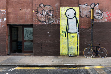 Worried-looking stick-figure street art