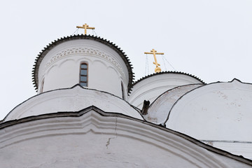 Spaso-Priluckiy monastery in winter. Spassky Cathedral. View of the domes and golden crosses. Detail of facade. Vologda. Travel north Russia. Ancient architecture. Saviour Priluki Monastery in winter