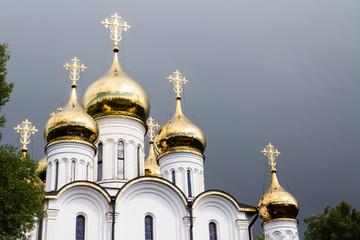 Russian church under stormy sky - St Nicolas monastery in Pereslavl-Zalessky, Russia