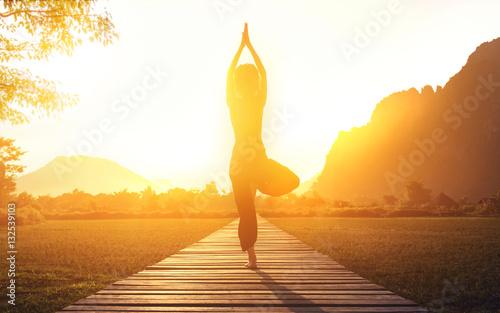 Wall mural serenity and yoga practicing at sunset, meditation