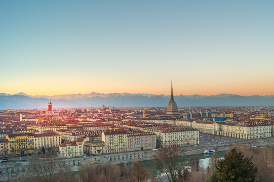 panorama of the city of turin from above at sunset with mole Antonelliana