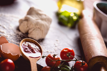 Homemade dough, preparing natural pizza on wooden table