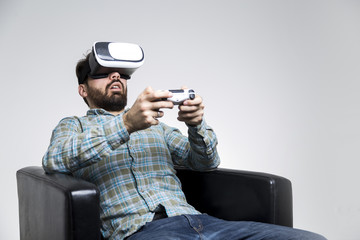 Bearded man in vr glasses with controller