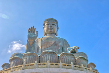 Tian Tan Buddha also known as Big Buddha, a large bronze statue at Ngong Ping on Lantau Island, Hong Kong, China. The sitting Buddha, icon of island, 34 meters high, draws pilgrims from all over Asia.