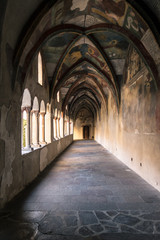 Cathedral cloister with the frescoed wall.