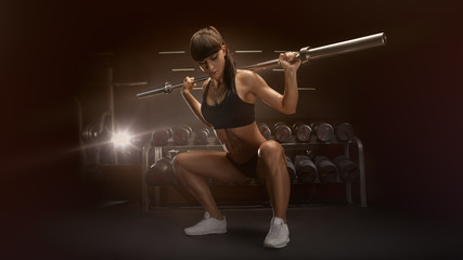Sporty sexy woman doing squat workout in gym