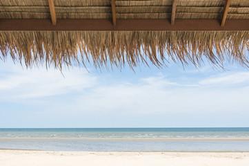 Beautiful tropical beach with white sandy beach from bamboo hut in hua hin Thailand