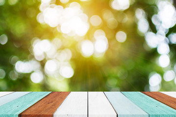 Empty vintage wooden table top and sunny blurred bokeh background. for product display
