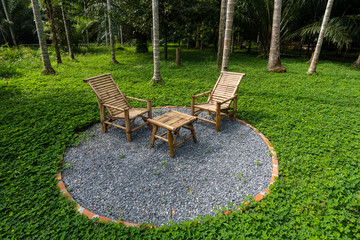 Two Bamboo  chairs and Bamboo table  in backyard. Relaxing garde