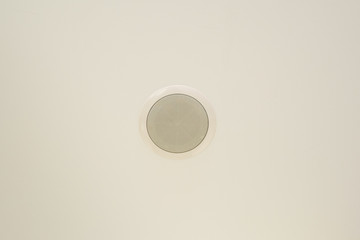 In wall speaker at the white ceiling