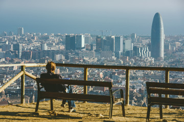 Barcelona, panoramic view. Man reading a book in foreground
