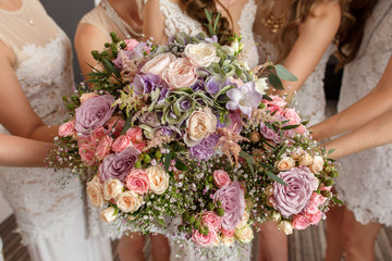Wedding flowers, bride and bridesmaids holding their wedding bouquets at morning. Wedding day concept