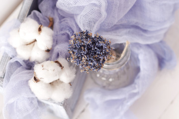 lavender and cotton with violet textile on white wooden table. s