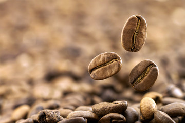 Flying fresh coffee beans as a background with copy space. Coffe