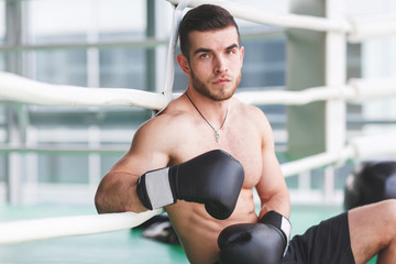 Young sportsman near boxing ring