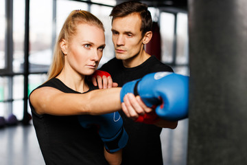 Boxing coach trains young woman