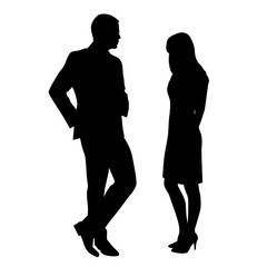 Man and woman standing and talking, flirting. The man is wearing
