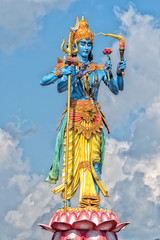 shiva statue in the blue light sky background