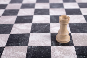 white wooden rook on chessboard