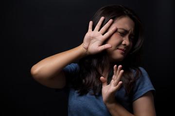 Sad woman on isolated black background