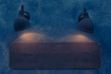 wood sign board on wall with lamp of light on wall