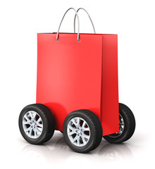 Red paper shopping bag with car wheels
