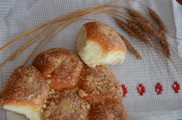 Bread on waffle towel embroidered with Russian, the concept of rural lunch, healthy food, agriculture, baking