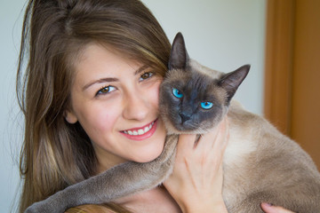 smiling young woman with her cat