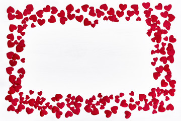 Valentines Day background with red hearts. Border, copy space