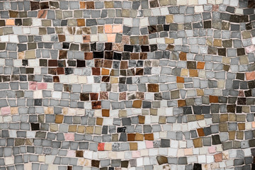 Vintage wall mosaic with neutral tone rough cut tiles