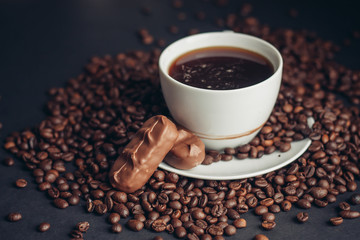 a cup of fragrant coffee, grains, a delicious drink, a chocolate bar