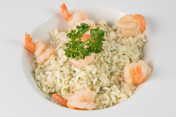 Shrimp or prawn risotto rice on white plate