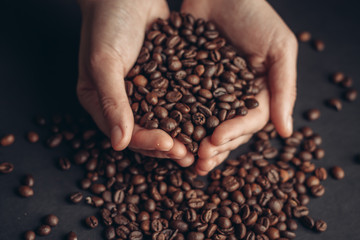 fragrant coffee beans in hands