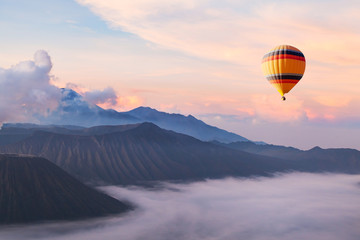 Poster Balloon beautiful inspirational landscape with hot air balloon flying in the sky, travel destination