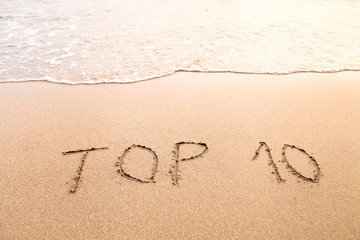 top 10, sign on the sand beach