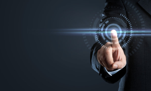 Business man touching virtual interface button