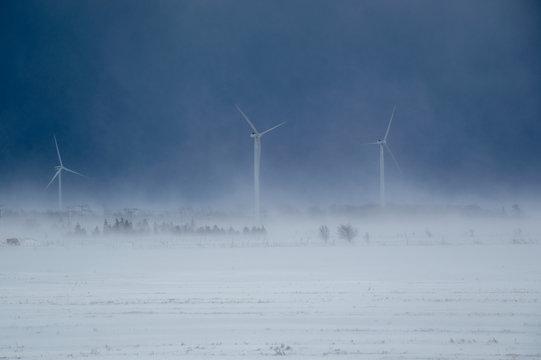 Alternative energy wind turbines in a snow storm