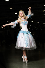 Young woman cosplayer wearing beautiful dress posing