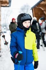 Child preparing for skiing.
